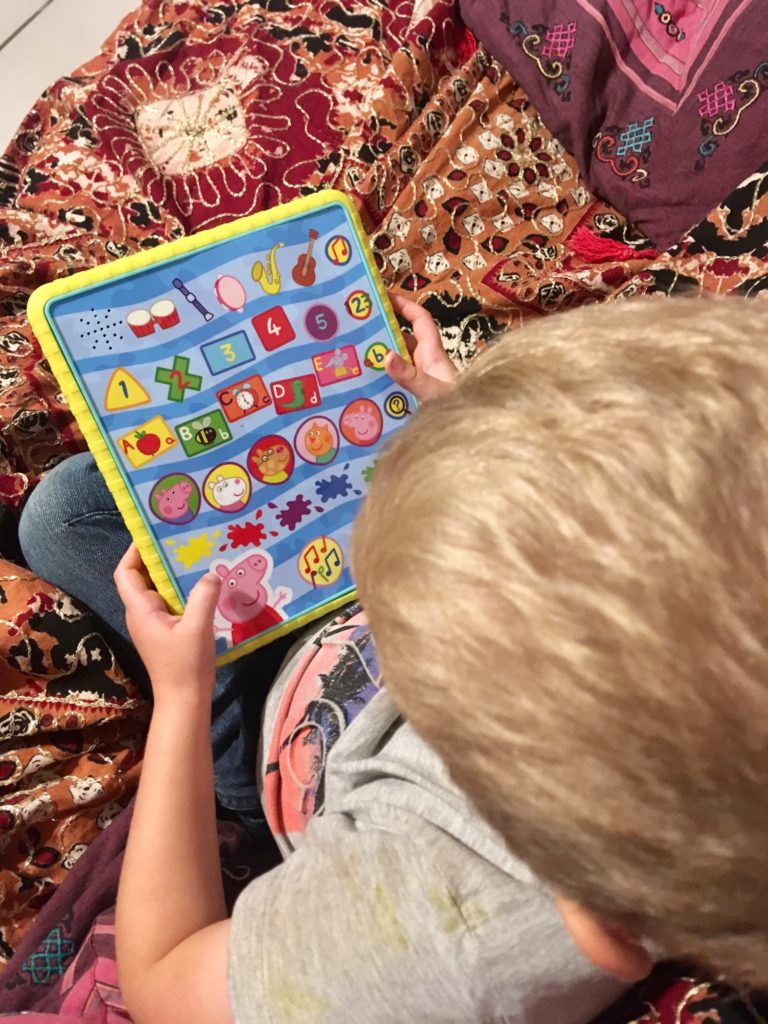 Lucas playing on the Peppa tablet