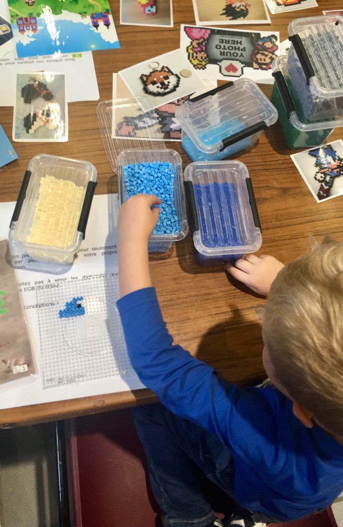 Lucas making a Hama bead dolphin