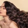choosing hair extensions. A lady with very long wavy brunette hair