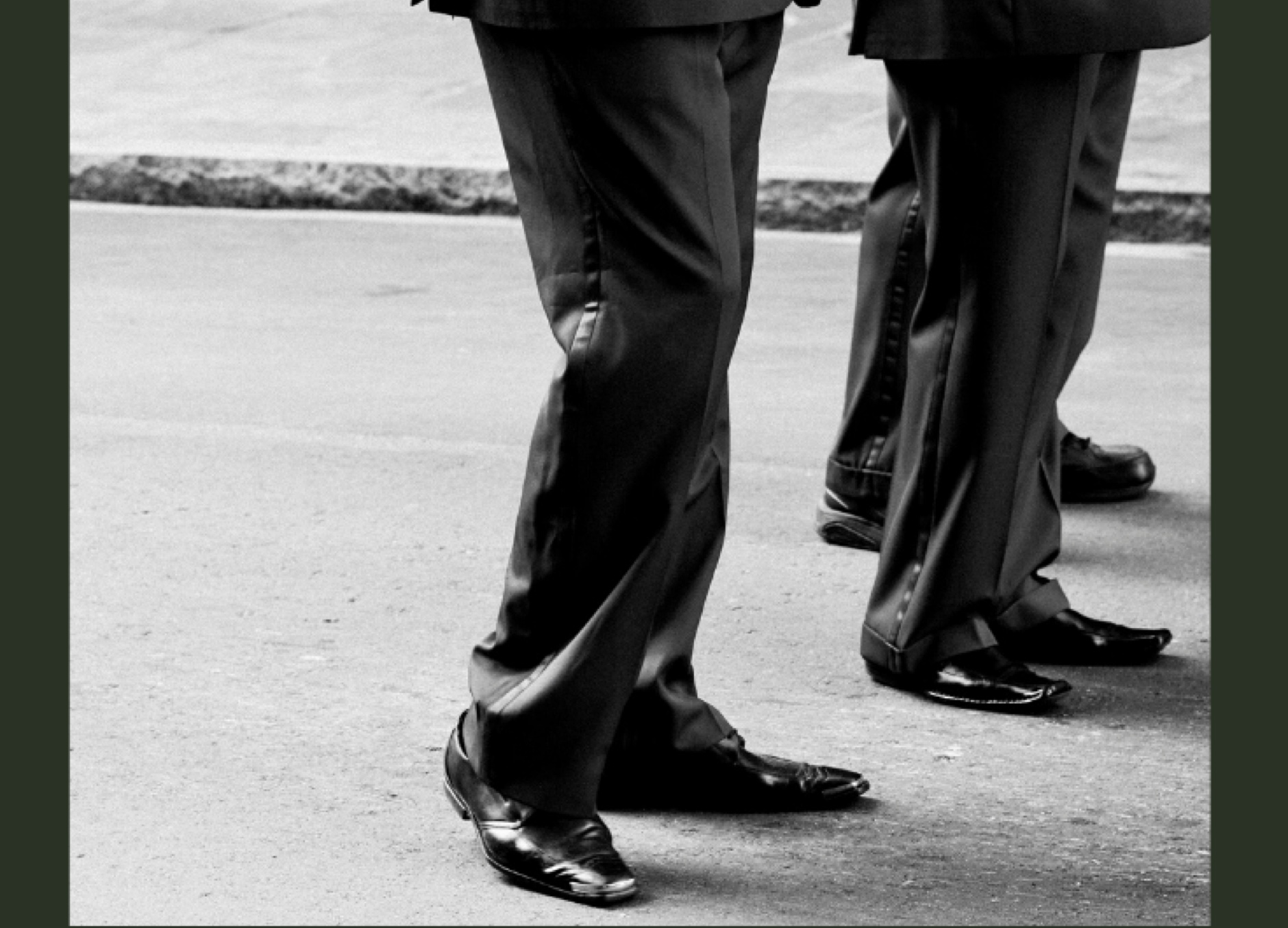 mens legs in trousers and black shoes