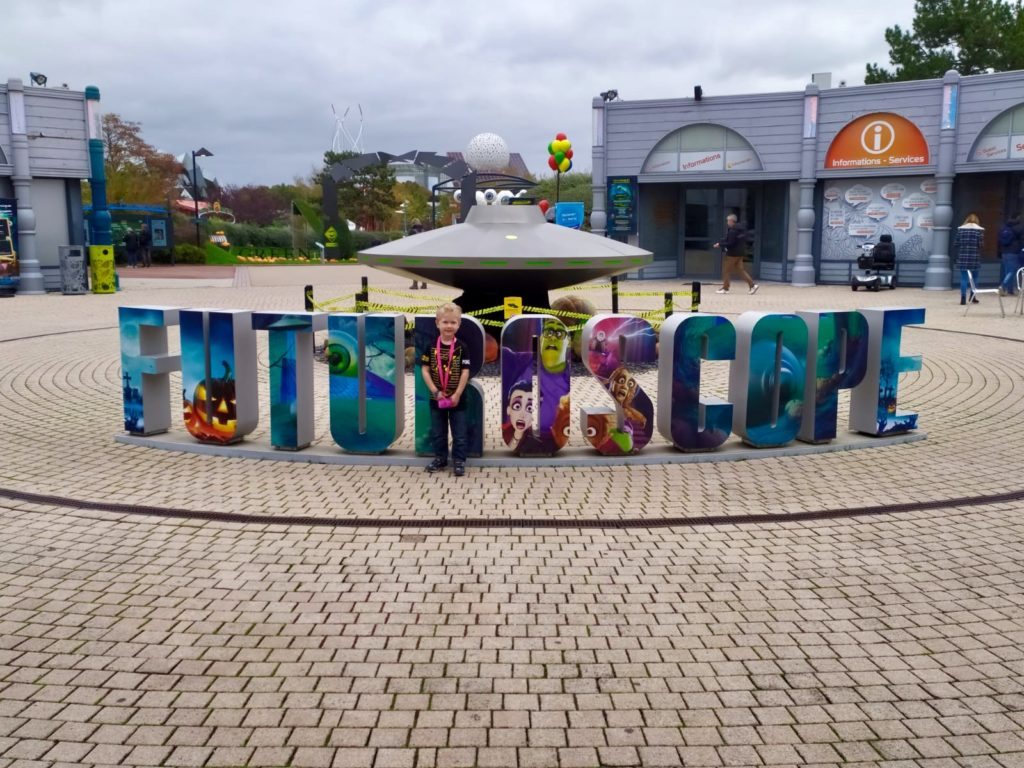 Futuroscope France review. Lucas stood in front of the Futuroscope sign