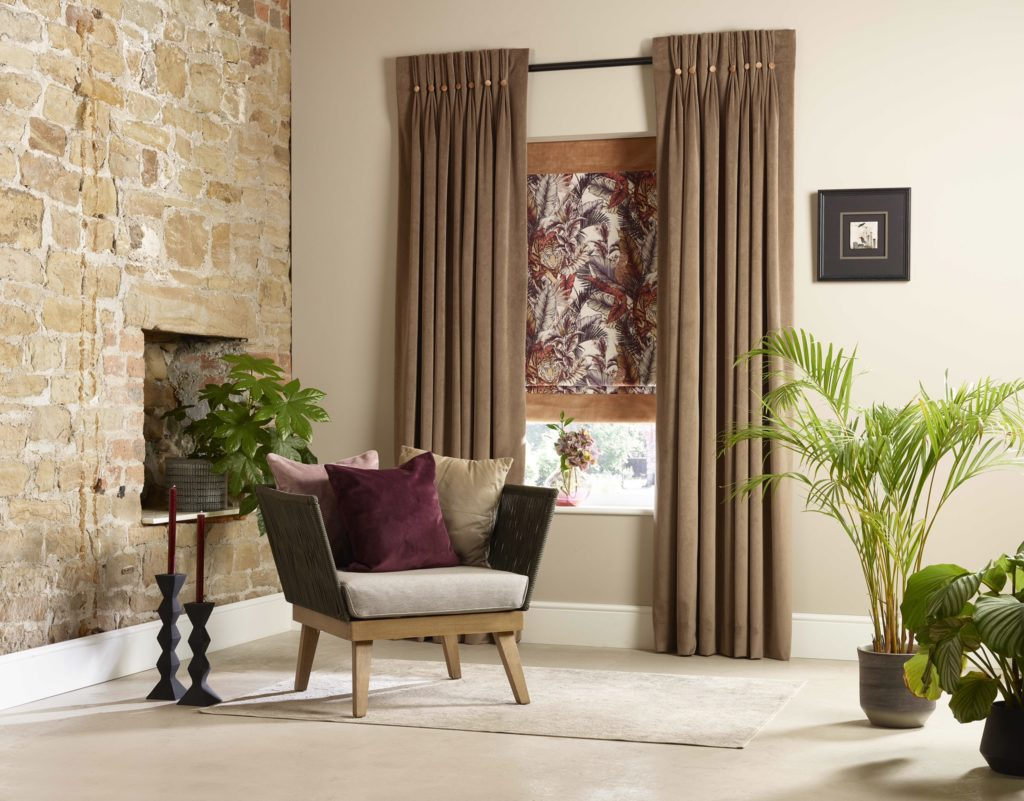 Winter proofing your house Photo shows a chair and plants in a living area. Behind is a window with a blind and floor length curtains