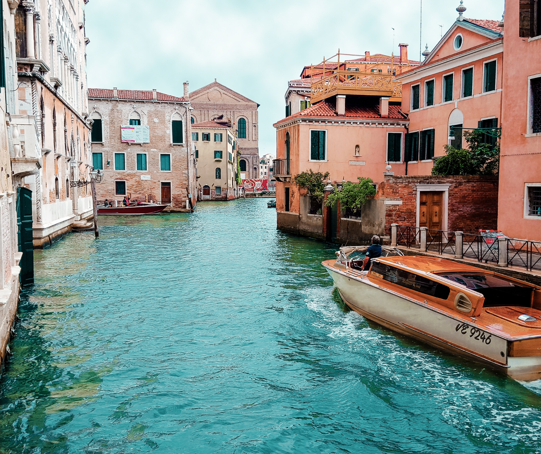 an italian canal surrounded by houses