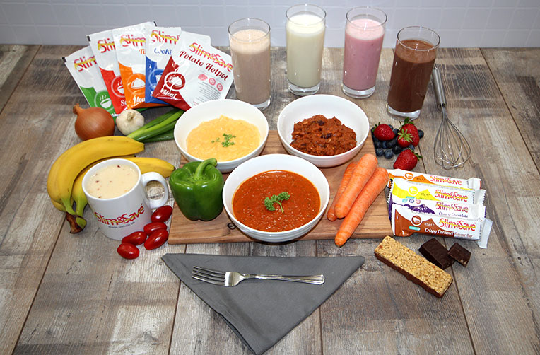 slim and save sachets, milkshakes and food prepared. All laid out on a wooden table