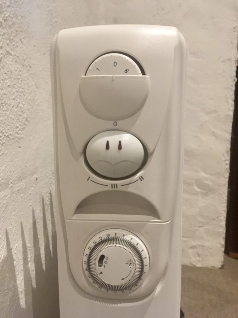 A close up of the dials on the oil filled radiator