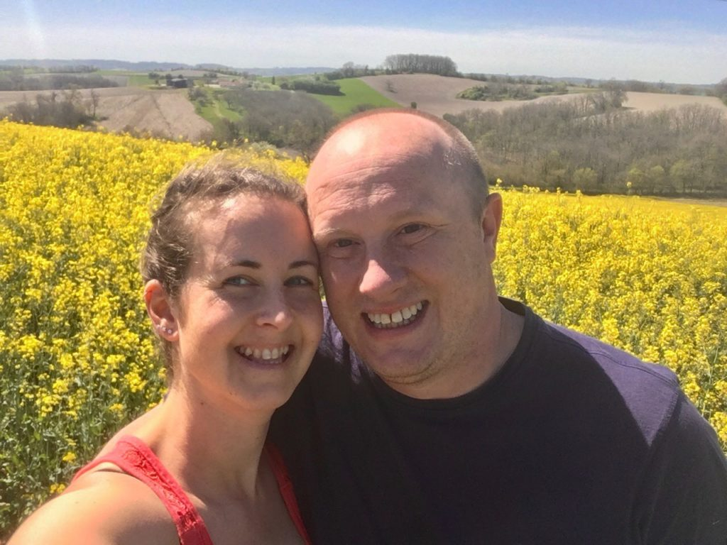 A close up of D and I I'm front of yellow rapeseed field