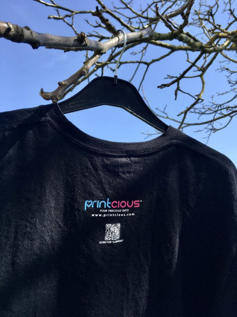 the reverse of the printcious tshirt showing the printcious details