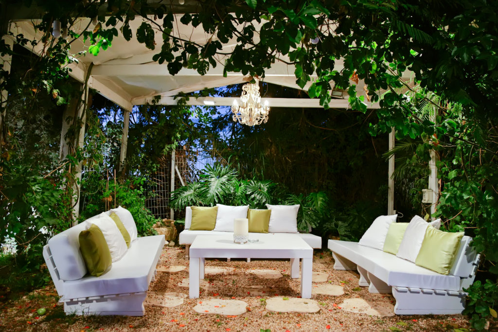 garden lighting with patio romantic in the evening with benches and pillows chandelier and table