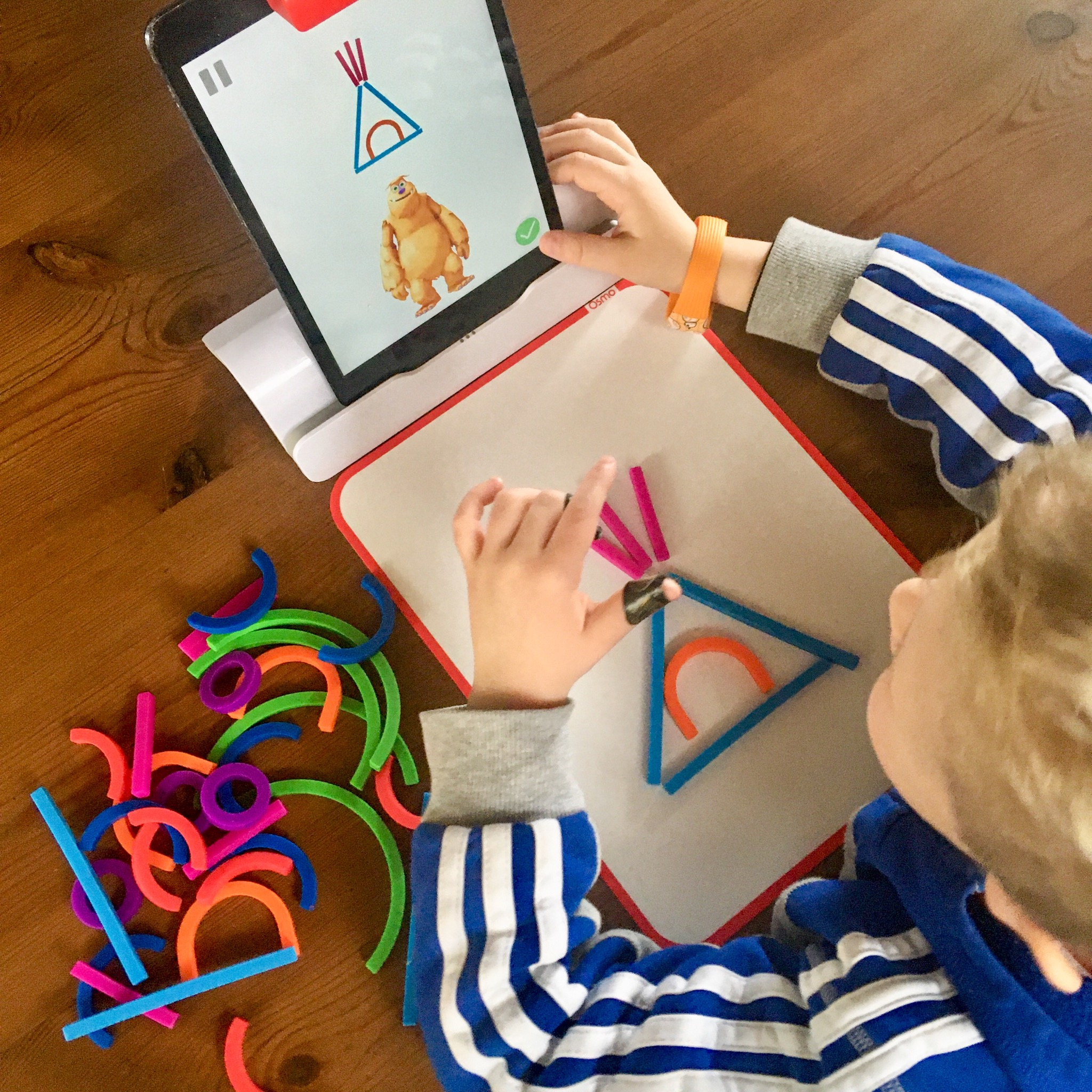 Lucas playing with the osmo app. Creating a tippee out of silicon pieces
