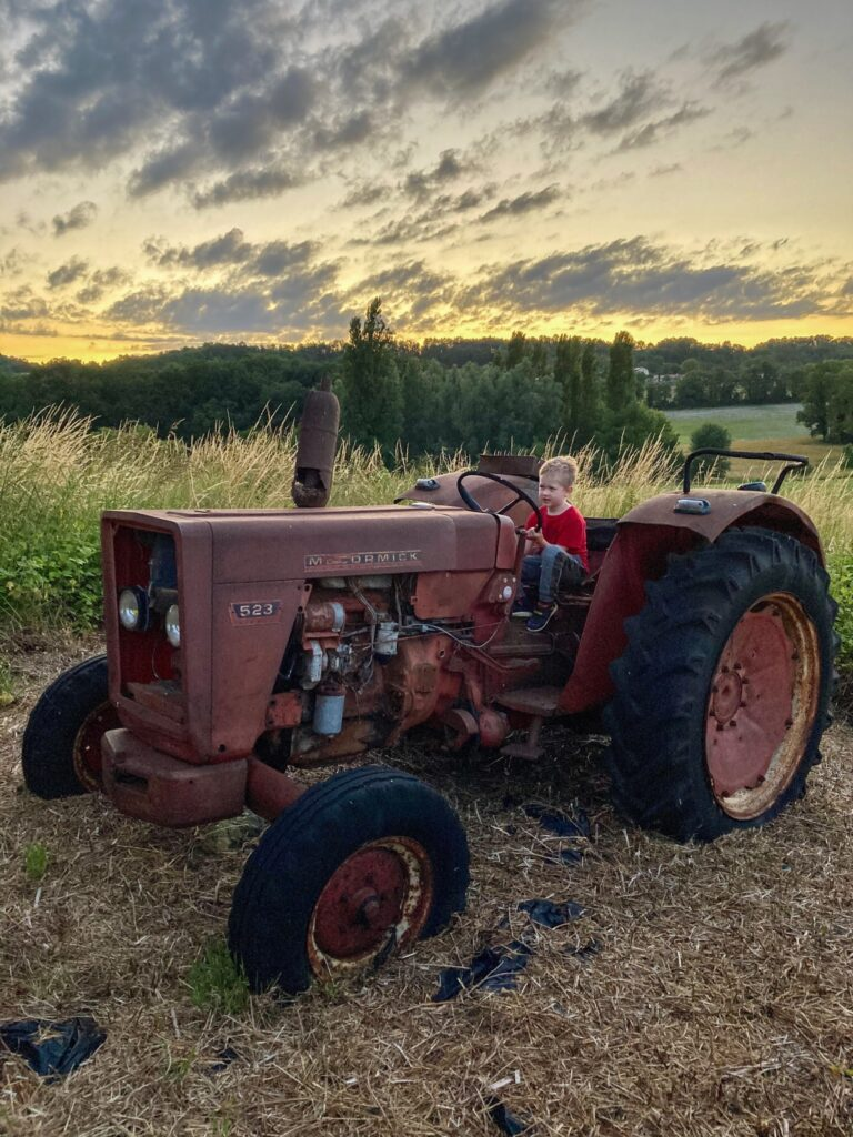 Lucas sat on an old tractor