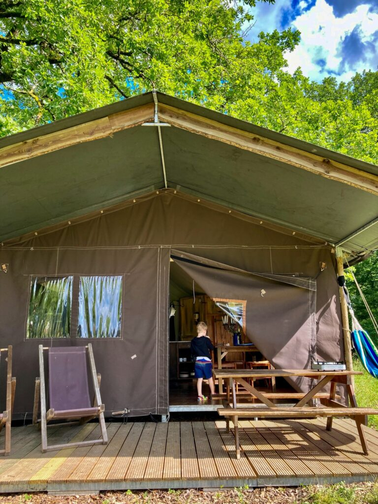 Brown canvas glamping tent at a Featherdown site