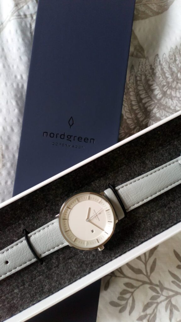 The Nordgreen watch in its case which is a soft black box
