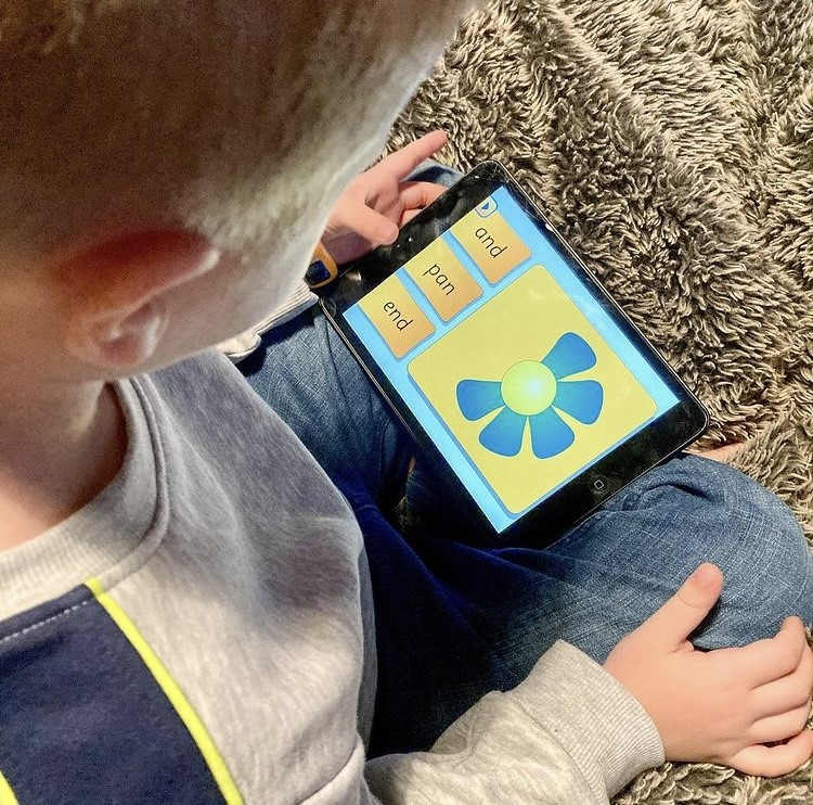 Lucas using reading eggs on ipad