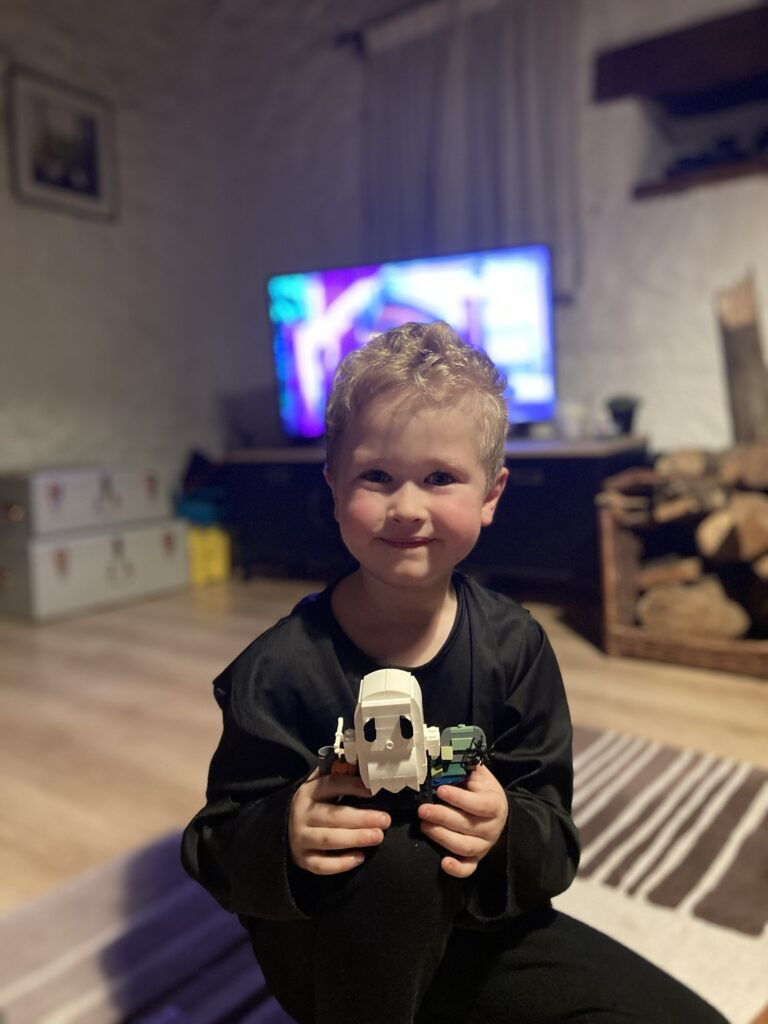 Lucas holding a ghost Lego
