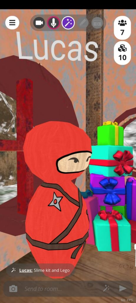 Lucas avatar which is a red ninja next to a pile of presents