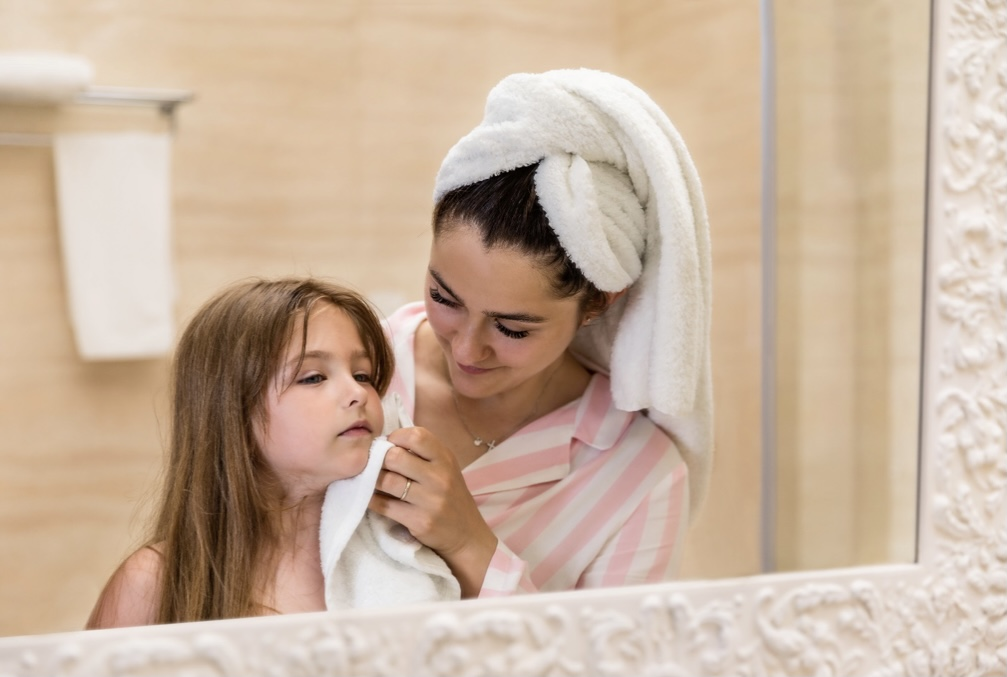 Mother with towel on her hair and daughter
