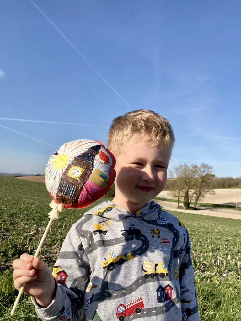 Lucas holding a balloon that had Big Ben on