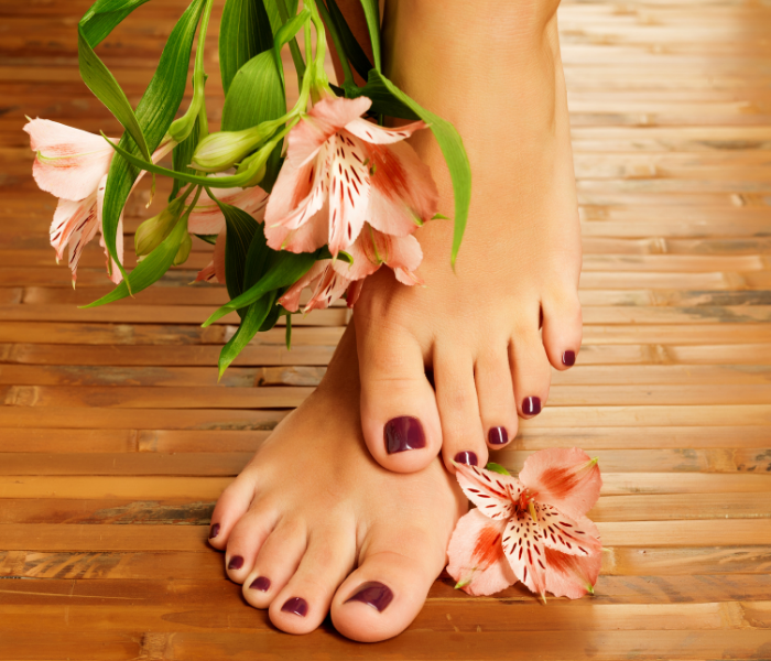feet with painted toenails in a deep red colour