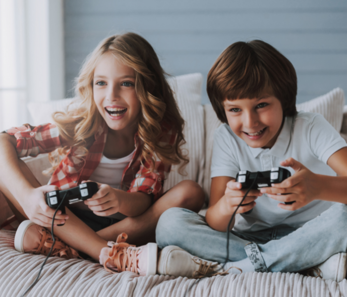 2 children playing on a video game